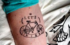 bicycle tattoo with an artsy vintage flair