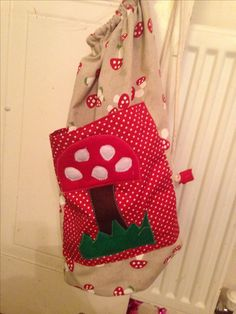 Duffel bag made from a cath kidston pattern with toadstool applique and toadstool fabric :)