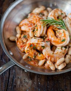 Shrimp Scampi with Cannellini Beans:  shrimp tossed in red pepper flakes, garlic, and olive oil sauteed with cannellini beans and rosemary.  Sauce made by stiring in tomato puree, a little bit of water and butter. Serve over brown rice or pasta!