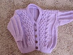 Delicate cabled cardigan with pretty floral details. Free Pattern