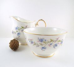English Bone China Creamer and Sugar Bowl. Duchess Tranquility Pattern. Milk Jug and Sugar Bowl with Pretty Forget Me Nots. Blues and Pinks