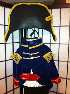 Napoleon Bonaparte - the kids could make a hat like this.