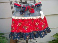 A pair of girls jeans were redesigned into a girly cowgirl skirt. Ruffles were added along with a cluny lace. A n added reversible tie belt in matching fabric. Stretchy denim fabric.    Ready to ship..    Girls 14    26 Waist  31 Hips  17 Length    Please feel free to contact me with any questions.    Will combine shipping...    Visit my other Etsy shops: YesterYearsChildren.etsy.com  RetroScenee09.etsy.com  ReDesignsbyCherylAnn.etsy.com  TheSewingDen.etsy.com      Thank you for visiting…