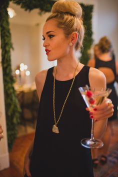 Love this whole look... black shift dress + long gold necklace + red lip + red nails + top knot