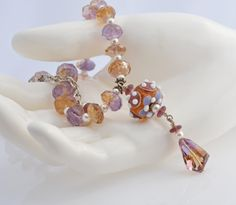 Lampwork White Pearl and faceted Ametrine by HoneyFromTheBee