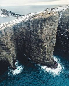 Even more Faroe Islands because it is beautiful. Tag a friend who is crazy enough to jump off of this! PC: @craighowes by travelsalt