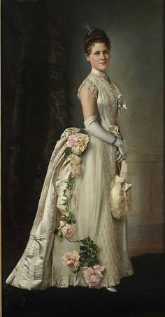 Portrait of an Elegant Lady Francois Brunery with next to it a Worth gown from 1880, also heavily decorated with roses.