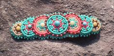 Check out this item in my Etsy shop https://www.etsy.com/listing/53543673/native-inspired-hair-barrette-beadwork