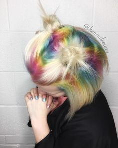 """Kenna Dupuis (@kennaleeann_hairstylist) put together a look meant to """"turn heads"""" on co-worker Hannah McKay (@dolledupbyhannah). Hannah came to Kenna with an idea of doing pastel rainbow roots. They bounced ideas off one another to make sure that the hair would look great no matter where Hannah parted her hair. After considering many different techniques, they decided to combine their two favorites. Hannah formulated the pastel colors and then Kenna made her idea become a reality. Hair wa..."""