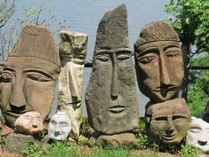 Ted Ludwiczak began carving stone in the late 1980s after retiring. The self taught artist came to carving stone heads while building a stone retaining wall near his house. Seeing a face in a rock he took a hammer and an old lawn mower blade and defined the form. Pleased with the results he felt, one head would look lonely, so he carved other stones heads in the wall.Hundreds of stone heads now make up the environment he refers his Easter Island set on a hillside.