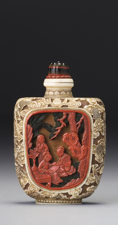AN IVORY, GOLD PAINTED AND LACQUER 'LADIES IN A GARDEN' SNUFF BOTTLE<br>JAPAN, LATE 19TH / EARLY 20TH CENTURY | lot | Sotheby's