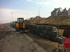 Precast concrete modular blocks being installed at Rhyl - March 2014 Precast Concrete, Concrete Blocks, Aac Blocks, Free Standing Wall, Modular Walls, Cost Saving, Retaining Walls, March 2014, The Locals