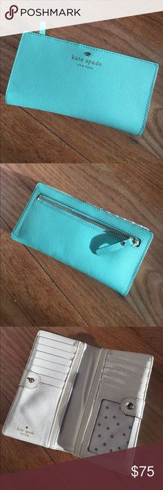 Kate Spade Cameron Street Wallet This piece is in amazing condition and perfect for the hot summer months! 😎 Cross hatched leather on the exterior in robins egg blue and smooth white leather with white gold polka dot cloth detail on the inside. No nicks or stains to the interior or exterior. Sale price firm. 👍🏻 kate spade Bags Wallets