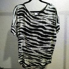 Zebra print stretchy top Super cute zebra print 3/4th sleeve top. Medium but has stretch so can fit a large too. Tops