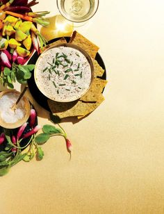 This warm, tangy twist on fundido is perfect with sparkling wine; the bubbles help cut through the richness. We pair with veggie chips, but you can also serve with crudités for a fresher take.