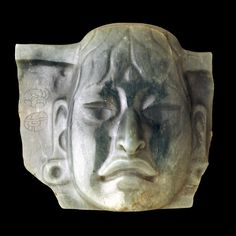 This pectoral (chest ornament), broken on both sides, was carved by an Olmec artist and reused by the Maya, as shown by the two Maya glyphs on the left side. The edges framing the head at the top and bottom indicate that it could also have been part of a larger pectoral.    Jade objects in Olmec style have been found throughout Mesoamerica and as far south as Costa Rica.