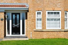 Full House of Georgian Bar High quality Rehau framework and Black Altmore composite door with Zinc Prairie Glass design and side panels of Pilkington textured glass.   Changing windows and doors can really change the front of a property for the better. Become the best house on the street with our fantastic quality Rehau UPVC Frames and Composite doors that come with a 10 Year guarantee to give you complete piece of mind.   #windows #georgianbar #altimore #compositedoor #frontdoor #door