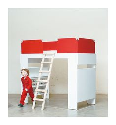 """Whether it's Max Bill's """"Ulmer Hocker"""" in red or storage boxes that call to mind overseas trunks: The interior design show """"Neue Räume"""" presents all things familiar – in a fresh look. A concept that goes down a real treat with the Swiss clientele. Elevated Bed, Loft Bunk Beds, Interior Design Shows, Kid Spaces, Kid Beds, Storage Boxes, Bedroom, Kids, Furniture"""