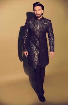 Ranveer Singh in a classic gota-patti work black bandhgala from Abu Jani Sandeep Khosla. Celebrity Look, Celebrity Dresses, Celebrity Weddings, Wedding Dresses Men Indian, Wedding Dress Men, Indian Groom Wear, Indian Men Fashion, Unique Fashion, Mens Fashion