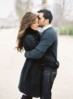 I love it when they're not just grinning into the camera.Timeless engagement photo.