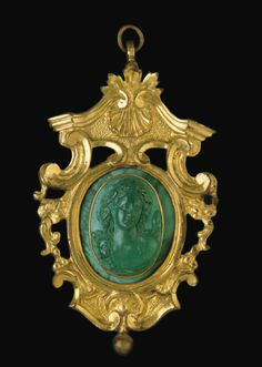 A CARVED OVAL MALACHITE CAMEO BUST OF A BACCHANTE -  19TH CENTURY