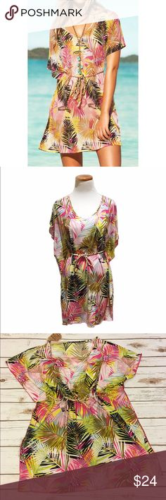 """Multi Color Leaf Pattern Cover Up/ Dress A beautiful soft lightweight cover up/ dress. Multi color leaf pattern. Can be worn as a cover up or dress. Has a rope that ties around the waist. Made of poly/ spandex blend. Stretchy material. Bust 40""""/ length 30.5""""/ rope length 52.5"""". One size fits most Swim Coverups"""