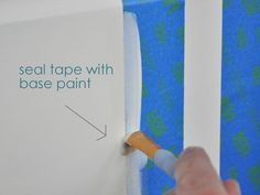 When painting stripes, seal your tape with white base paint first. So easy! Why didn't I think of that before?
