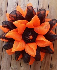 This Halloween Wreath would be a cute way to welcome your guest this Halloween. Wreath is made with Orange and black deco mesh with a burlap center and a little orange and black spider sitting in the center. Measurements are approximately 20 inches in diameter and 5 inches deep. All my wreaths are