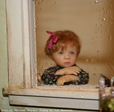 Doll by Catherine Muniere ~ I will stand my dolls in windows ~ where they don't get too much light