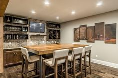Installing a bar in your home is a great way to make sure that when you have company over everybody has a fun place to spend time together. A dedicated bar spac Rustic Basement Bar, Wet Bar Basement, Basement Bar Designs, Basement Layout, Modern Basement, Basement House, Basement Walls, Basement Ideas, Basement Finishing