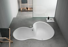 Take your place. Built-in DR bathtub by Studiomk27, Marcio Kogan and Mariana Ruzante, Memory taps, Stairs, Surf and X extra by Benedini Associati Design Consultant. #agape #bath #design #interior #bathroom