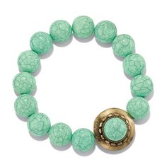 Burnished brass stretch bracelet with round turquoise colored beads. Bracelet has a burnished brass decoration on the bracelet. Shop my store 24/7 at  https://dtamplain.avonrepresentative.com/  #avon #avonjewelry #turquoisejewelry