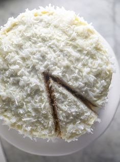 Moist, fluffy, and soft, this four layer Coconut Cake recipe has the perfect amount of sweetness that is filled and topped with coconut cream cheese frosting and even more coconut. Best Dessert Recipes, Fun Desserts, Delicious Desserts, Cake Recipes, Brunch Recipes, Holiday Recipes, Snack Recipes, Almond Muffins, Perfect Chocolate Cake