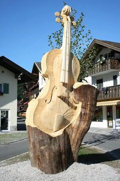 Repurposing Tree Trunks Or Stumps: tree-sculpture cello Chain Saw Art, Tree Carving, Pumpkin Carving, Tree Art, Public Art, Belle Photo, Wood Art, Sculpture Art, Driftwood Sculpture