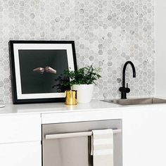 #repost via @thekitchenhub This is such a lovely, simple and beautiful kitchen featured in the amazing EST Magazine! http://estliving.com/magazine. Get the look with our Meir Matt Black Goosneck (3) & Mercer Stainless Steel Sink (2). Add some subtle Hexagon tiles like this Carrara Marble Mosiac (1) and BAM - you have yourself a lovely kitchen! #Meir #Meirblack #Meiraustralia #Blacktapware #Matteblacktapware #homeinspo #interiorlovers #interiorinspirations #kitcheninspo #renovationideas