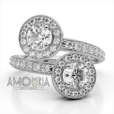 Celebrate your love with this exquisite two-stone diamond halo ring from Amouria. Crafted in either 14k, 18k, or Platinum, this exceptional design features two diamonds, representing your friendship and loving commitment. The smooth bypassing shank glistens with smaller round accent diamonds and wraps each diamond in a luxurious halo setting. Perfect for any love story, this ring truly captivates.  #amouriajewel #jewelry #vintage #classic #ring #crossed #diamonds #engagement #engaged