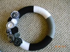 A Black Grey and White Yarn Wreath with Felt by TurtleLoveCrafts, $30.00
