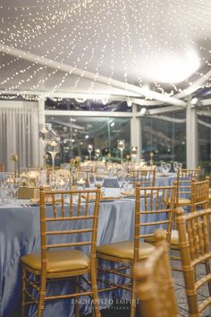 Under a canopy of fairylights this powder blue and gold wedding was the perfect style for this riverside location. Upon custom floor length satin linen, sat an array of floating candles, mercury gold vases filled with white blooms and bud vases, cradling rose stems to add a romantic whimsy to the dining space. Custom stationary kept the rose theme consistent with table numbers and individual thank you notes with an added bomboniere. Youtube: www.youtube.com/watch?v=2-cqj3D3WAc Enchanted…