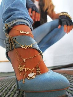 I kinda love everything about these shoes. Is that denim and a charm bracelet?!
