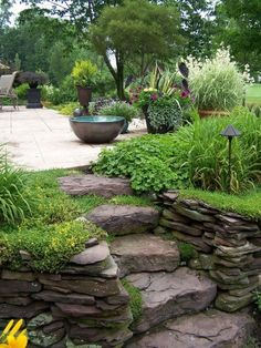 dry stacked stone retaining wall and rugged stone steps