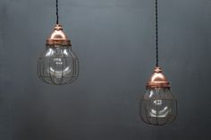 USA, 1940s, Vintage Industrial Copper Topped Caged Pendant Lights.
