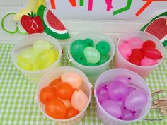 Fruit Ninja party! Fill a bunch of water balloons all 'fruity' colors.