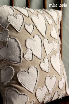 Heart pillow in neutral tones. This can go with a lot of color schemes and bring some charm to a room.                                                                                                                                                                                 More