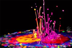 Microscopic drops of colour paints 'dancing' in time to music on top of a speaker.