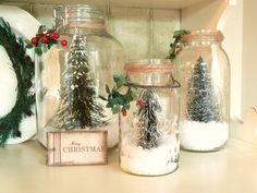 Kate's Place: Christmas Hutch. Dollar store trees, glass jars, jute twine and holly sprigs.  Not sure what the snow is, maybe sea salt?  Super cute and easy.