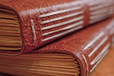 Leather journals by Zoë Scharf
