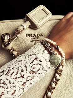 A Prada handbag...A Tiffany charm bracelet and a simple pearl (always a sign of exquisite style) bracelet...
