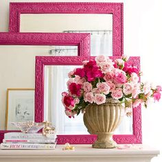 Pink mirrors and frames on dresser
