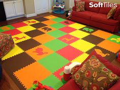 Large colorful children's playroom floor with SoftTiles Safari Animals foam mats. This mat is a custom designed play mat with the customer choosing all the colors and die-cut shapes. A beautiful and fun cushioned playroom floor.