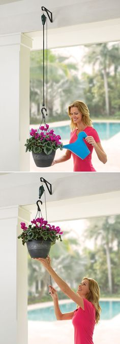 "The Planter And Birdfeeder Pulley System - This is the retractable pulley system that lets users effortlessly raise and lower plants and birdfeeders for watering and refilling. The device hangs between your plant or birdfeeder and an existing ceiling hook, suspending it from a sturdy woven band that supports up to 8 lbs. and extends up to 42"" from its case. A pull cord releases the band as your free hand guides the planter to your preferred height."